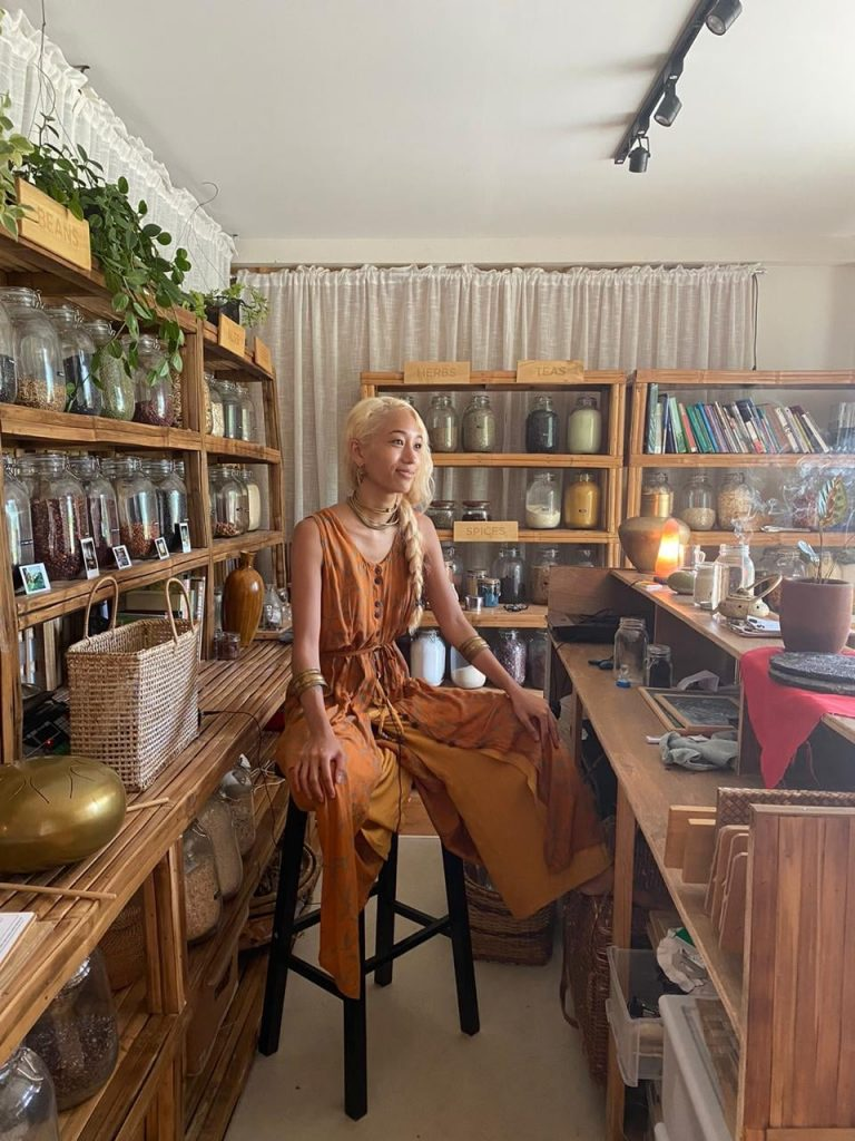 Filipina musician (((O))) behind the counter of The Living Library