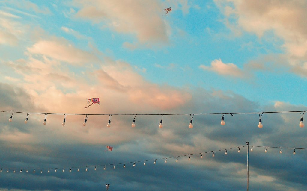 Enjoy a view of kites flying against the sunset.